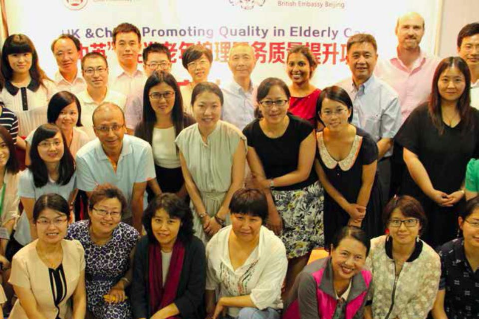 Sarasa Poduval (in red at back) with colleagues at an elderly care conference in China