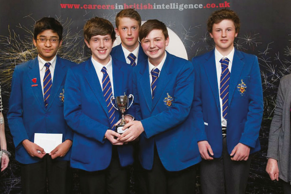 Photograph of school pupils holding a trophy.
