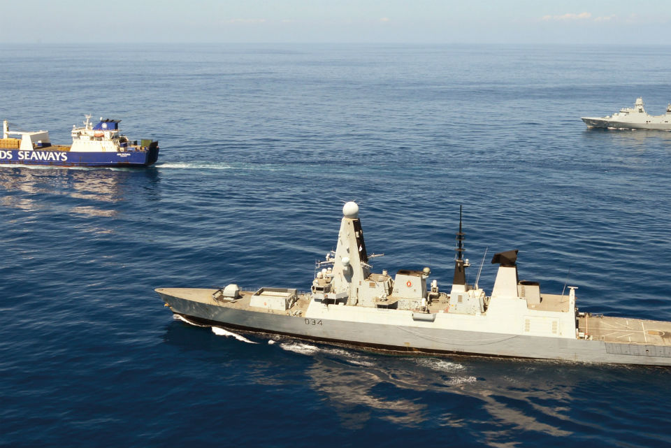 Image of HMS Diamond (foreground) and the Danish Peter Willemoes vessel (background), escorting the merchant ship Ark Futura.