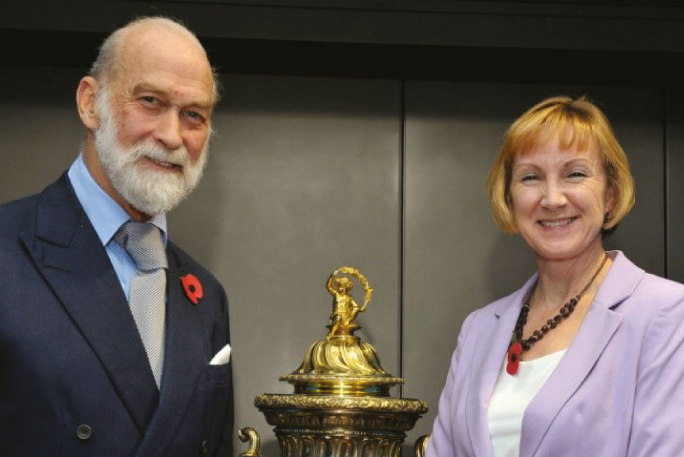 HRH Prince Michael of Kent presents the Threlford Memorial Cup to GCHQ's Language Outreach Coordinator.