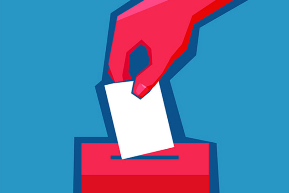 Graphic of a hand putting a voting slip into a ballot box
