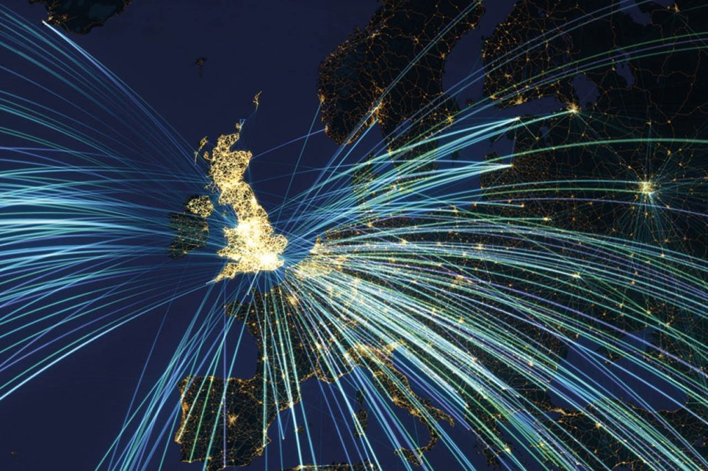 Nighttime satellite photo of Western Europe showing illuminated flight paths from and into the UK