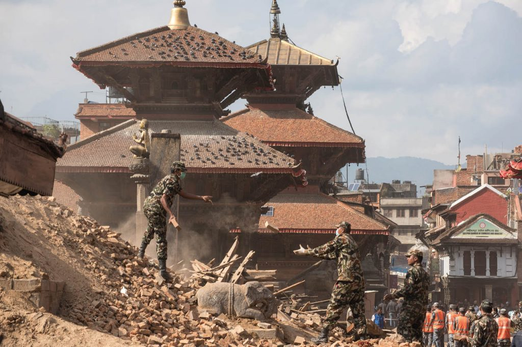 Soldiers searching earthquake rubble