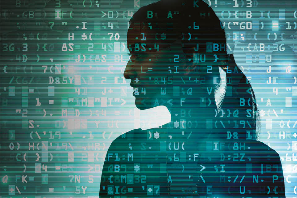 Woman's silhouetted against image of data streams