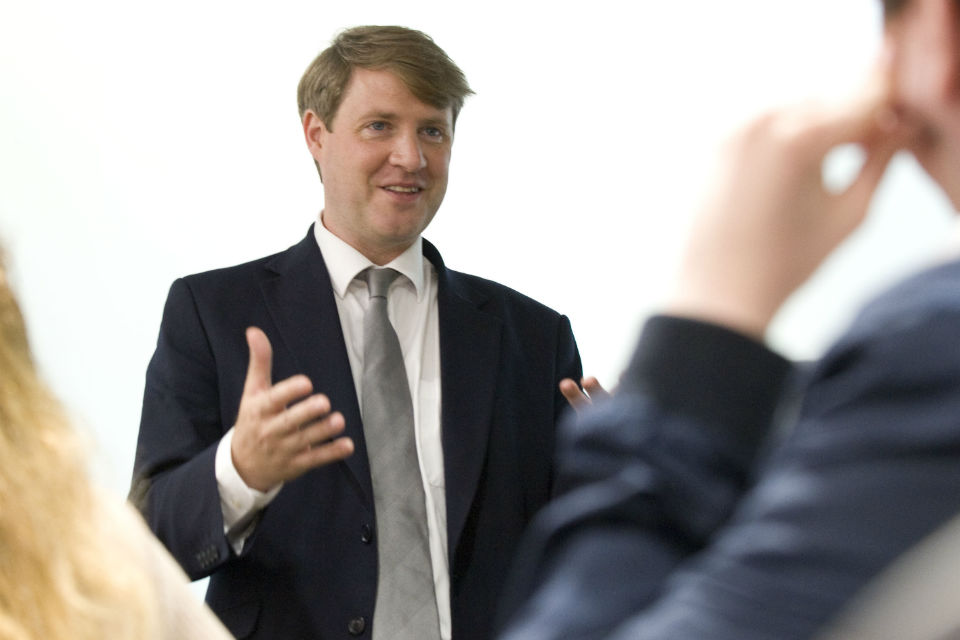 Man in suit addressing audience
