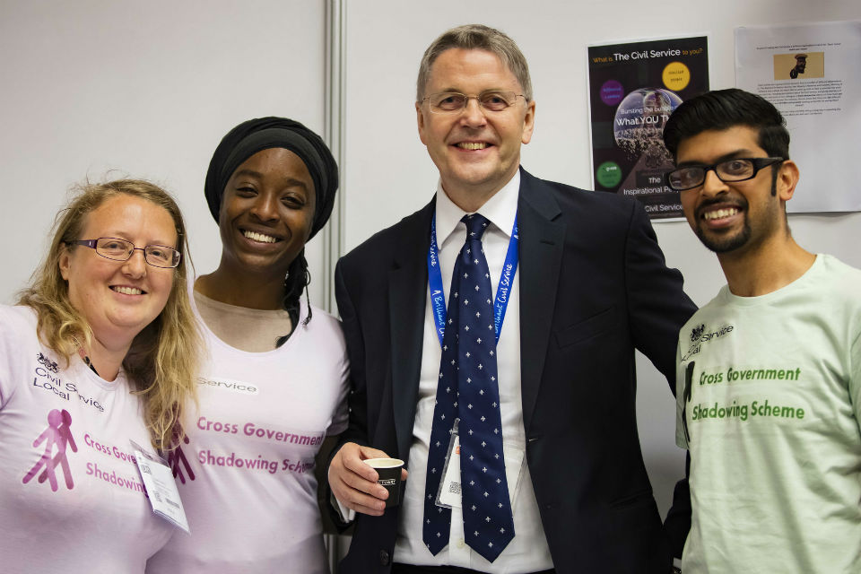 Three members of diversity scheme with head of civil service