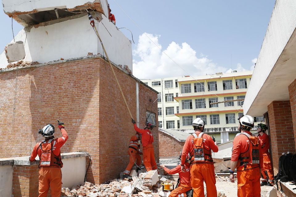 Firefighters at work in earthquake damaged hospital in Nepal