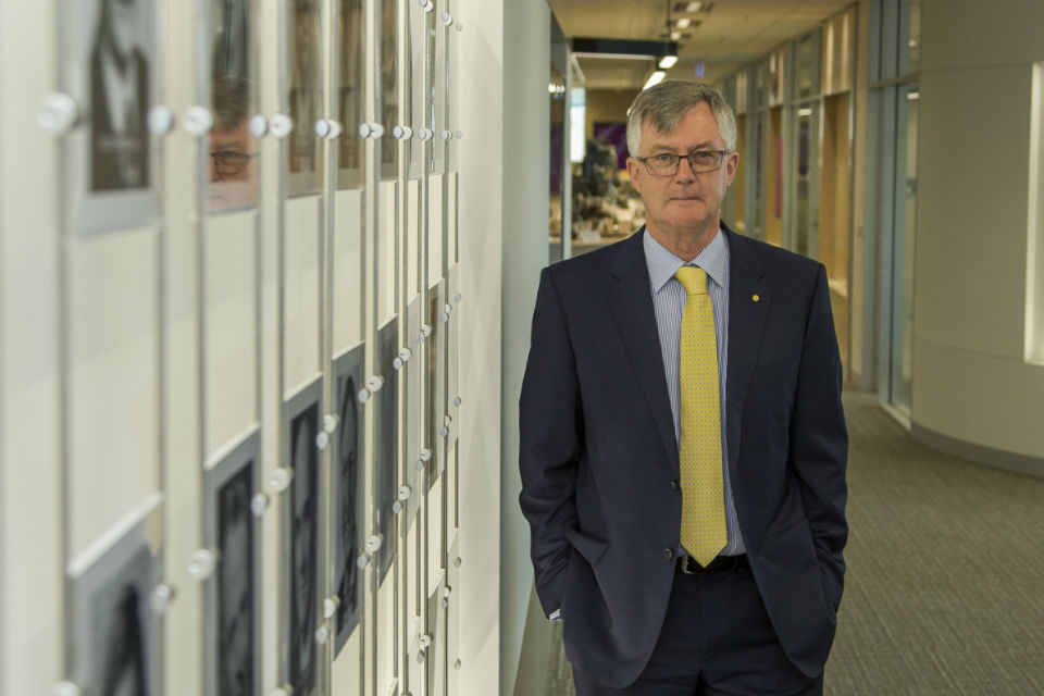 Martin Parkinson standing in an office corridor