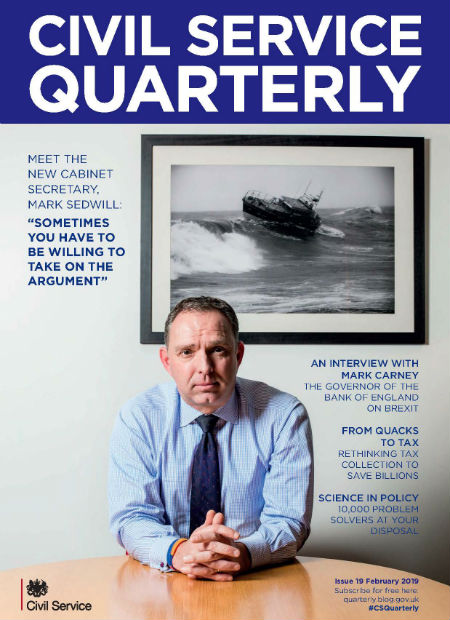 Front cover of Civil Service Quarterly 19, featuring a photograph of a seated Mark Sedwill, Cabinet Secretary, with a framed photo of a lifeboat at sea on the wall behind him