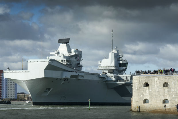 HMS Queen Elizabeth sailing from her home in Portsmouth for the first time after being officially commissioned into the Royal Navy