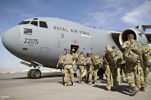 UK troops boarding an RAF transport plane to leave Afghanistan