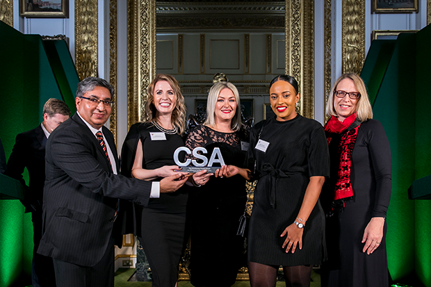 Members of the Department for Education's Care Leaver Policy Team, with their Developing People Award, and award presenter Elizabeth Gardiner, First Parliamentary Counsel