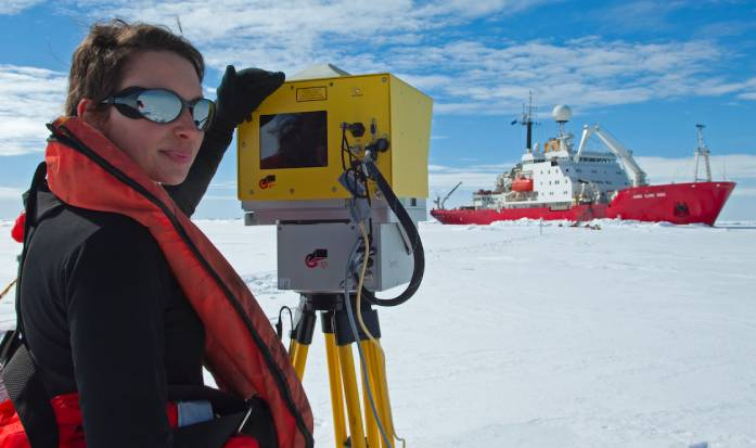 A scientist from the British Antarctic Survey taking readings using LiDAR (Light Detection and Ranging) technology